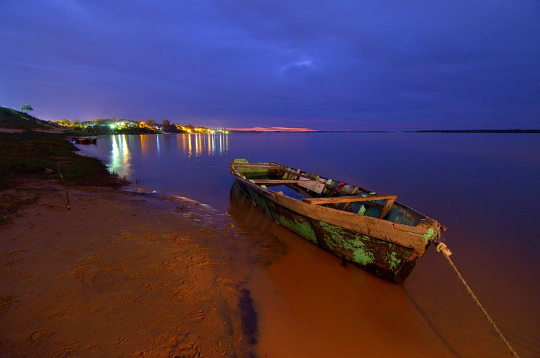 The bright lights of the riverside beach at Ituzaingó