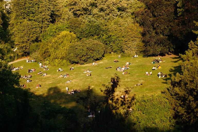 People enjoying Parc des Buttes Chaumont │© Kim Grant for Culture Trip