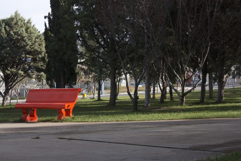 A bench painted red for Wales in Trelew