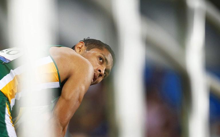 Wayde van Niekerk rests after his win