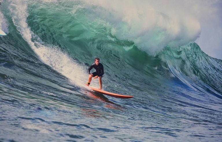 Surfer riding large Waimea waves