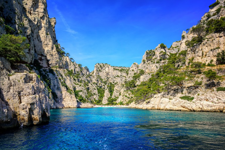Finish off your 48 hours with a drink and swim in the Calanques