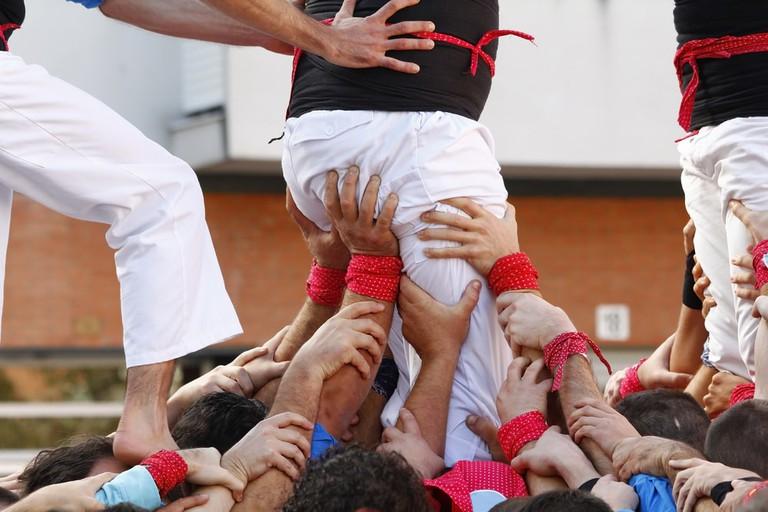 Castellers building a human pyramid | © Jordi C/Shutterstock