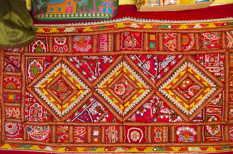 A handstitched mirror-work bedcover made in India