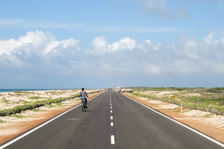 The roads of Rameshwaram are flanked by the Arabian Sea