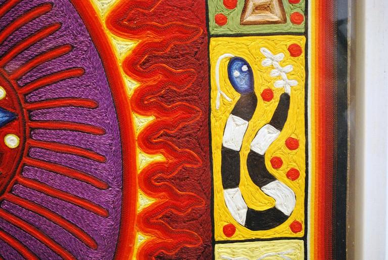 Close up of Huichol string art