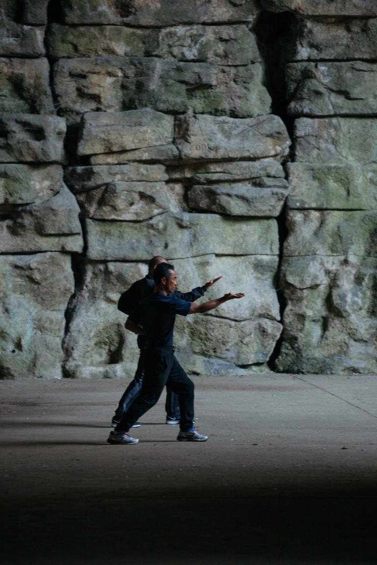Tai chi at Parc des Buttes Chaumont │© Kim Grant for Culture Trip