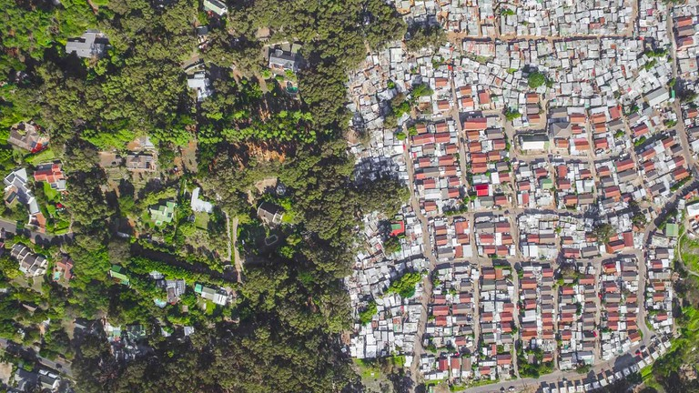 The wealthy suburb of Hout Bay alongside informal settlement Imizamo Yethu