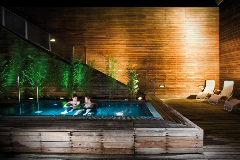 The heated outdoor pool at night