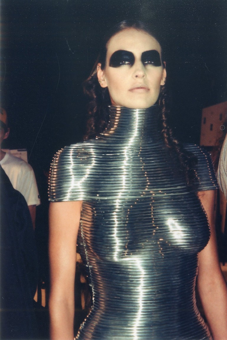 Backstage at the Alexander McQueen 'Black' show, June 2004. Aluminium Coiled Corset by Shaun Leane for Alexander McQueen, The Overlook, Autumn/Winter 1999   Courtesy of the Shaun Leane archive