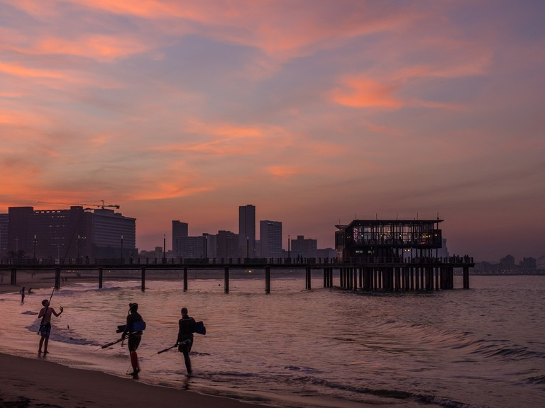 Take a stroll along the beach at sunset
