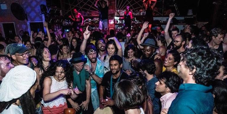 The crowd gathers around a drummer