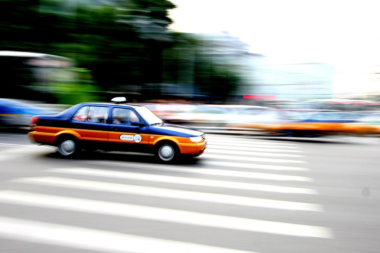 Beijing cabs can be pretty difficult to hail on streets