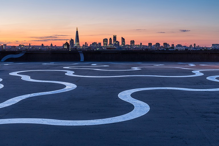 Agora by Richard Wentworth, painted in aluminium rich paint. Commissioned by Bold Tendencies on the roof of a disused multi-storey car park in Peckham, London, June 2015