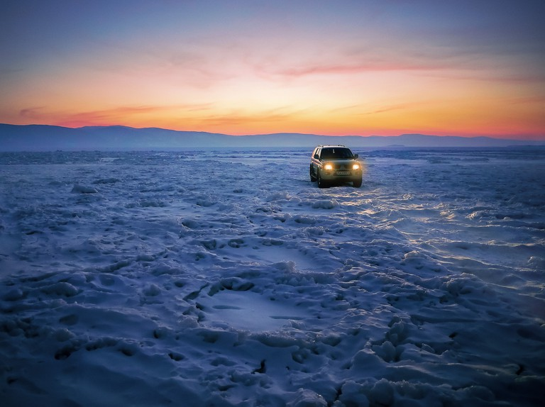 Frozen Baikal becomes a road as well