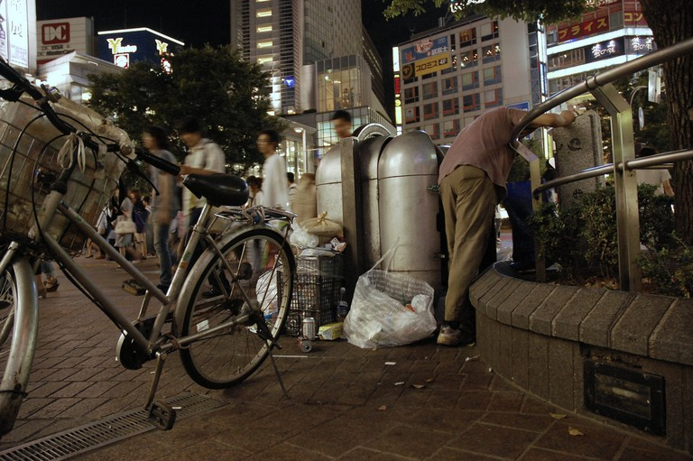 Digging through the trash in Shibuya, Tokyo