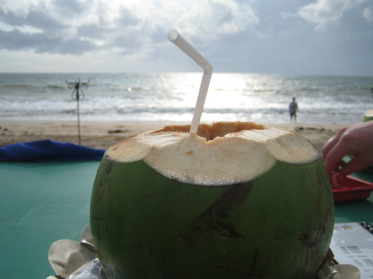 Young coconut ice on the beach