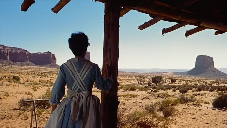 Martha (Dorothy Jordan) watches Ethan's approach at the start of the film—Monument Valley standing in for rugged West Texas