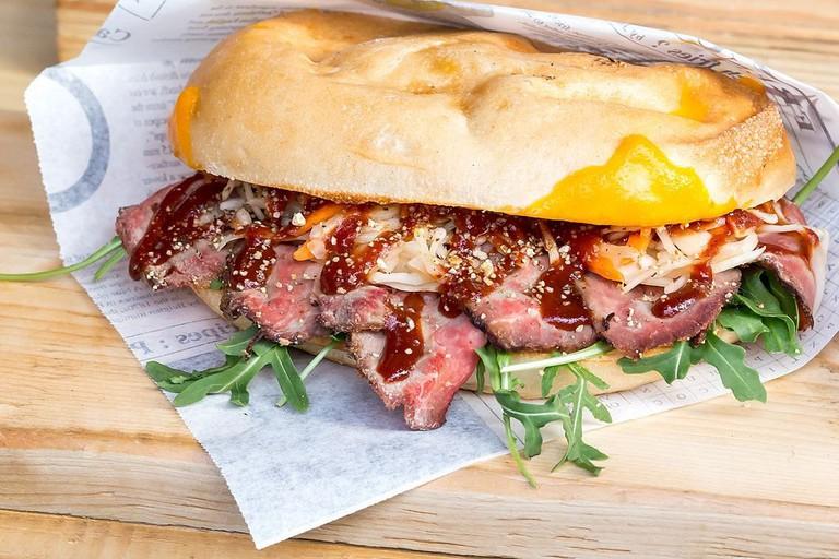 American panini with roast beef, rocket, cheddar, kraut salad and BBQ sauce