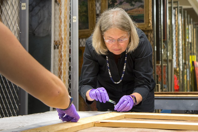 Nancy Odegaard, Arizona State Museum Head of Preservation, prepares recovered de Kooning painting for inspection and authentication | Courtesy of the University of Arizona Museum of Art
