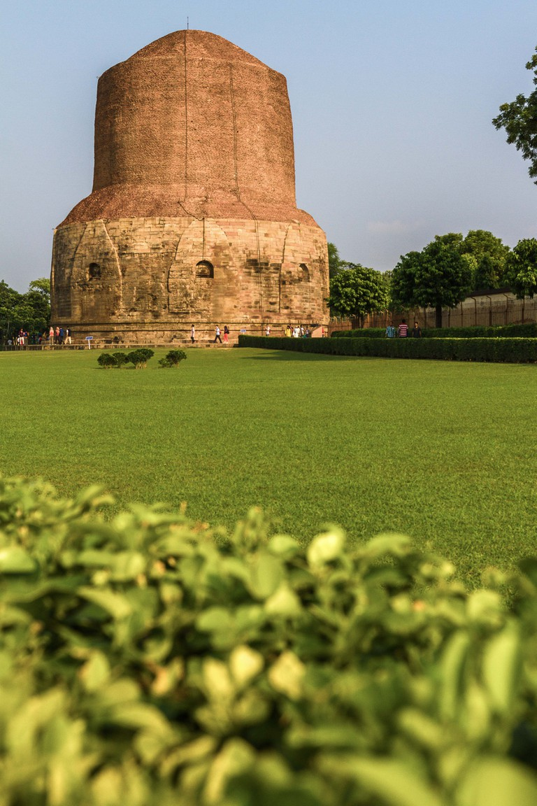 "The Dhamek Stupa in Sarnath, 13 kms away from Varanasi | <a href=""https://commons.wikimedia.org/wiki/File:Dhamek_Stupa,_Sarnath.jpg"">© GONG JIE / Wikicommons</a>"