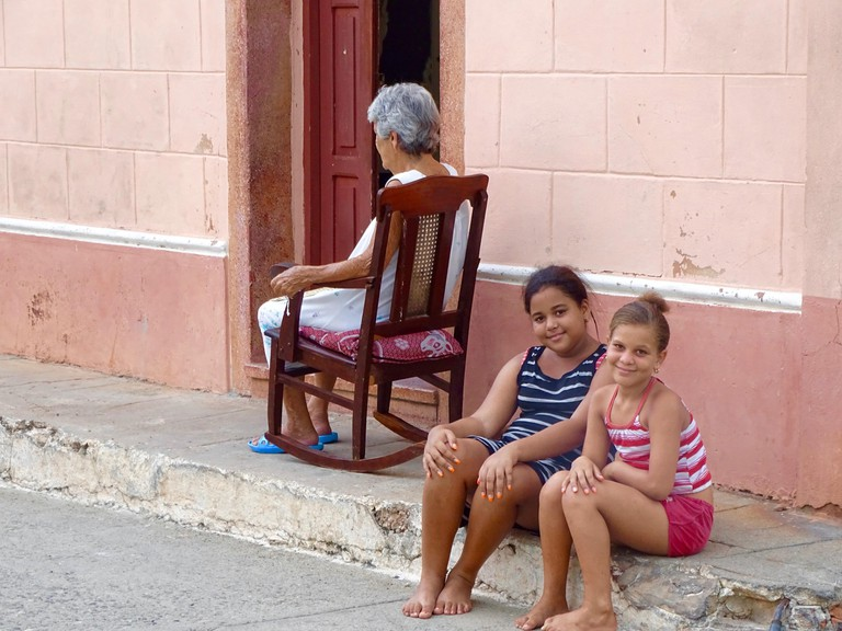 Local children posing for the camera in Havana, Cuba
