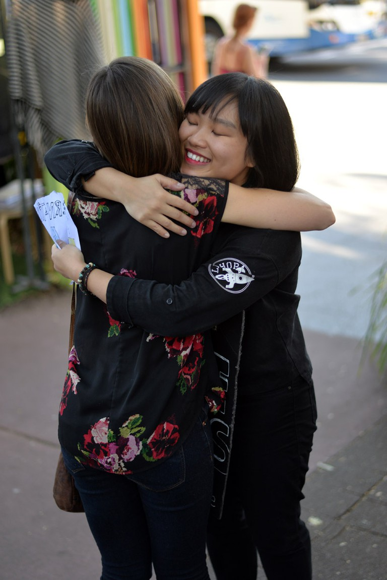 A free hugs event hosted by the Sydney team