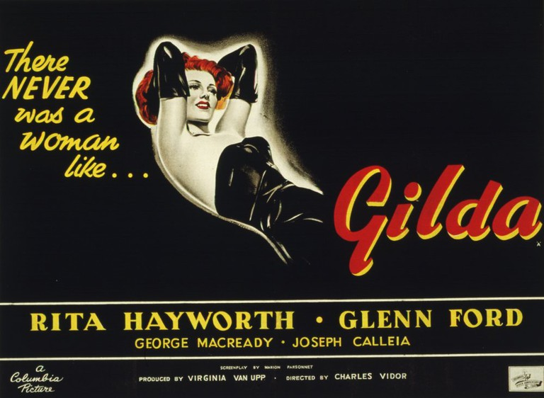 """Gilda (Hayworth) in the dress she wears and the gloves she removes while singing """"Put the Blame on Mame""""   © Columbia Pictures"""