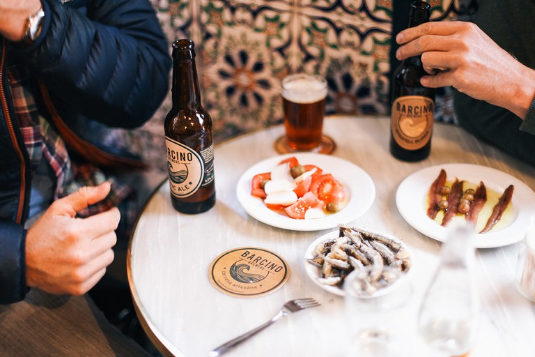 Try Barcino beers with local tapas Courtesy of Barcino Brewers