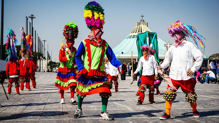 Indigenous dancers perform on the grounds of the Basilica de Guadalupe, Mexico City