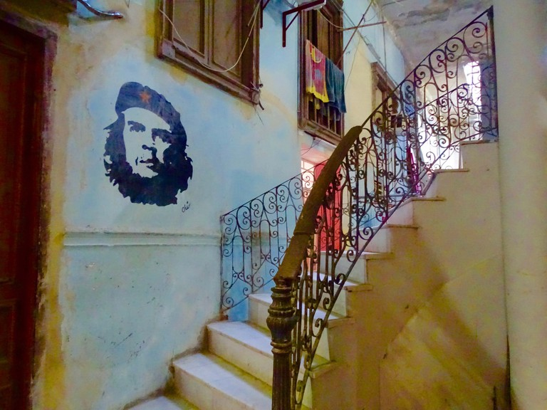 An image of Che inside a hallway of a mixed-used building   © Amber C. Snider