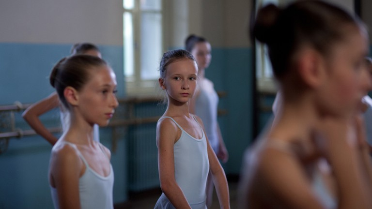 Veronika Zhovnytska (center) as eight-year-old Polina | © Oscilloscope