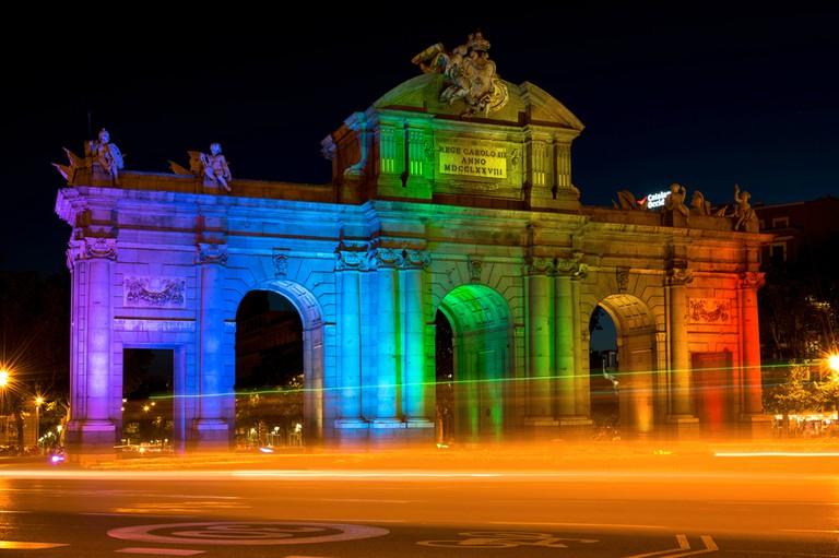 Puerta de Alcalá lit up in rainbow colours during Pride