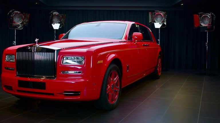 The 13 has splashed out a whopping US$20 million on a fleet of 30 bespoke, red, extended wheel base Rolls-Royce Phantoms I Courtesy of The 13 Holdings Ltd