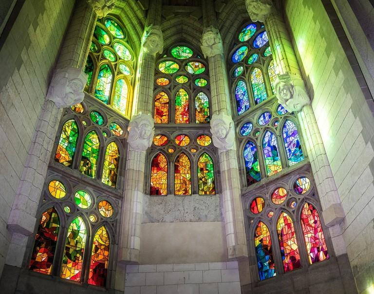 Stained glass windows illuminate the church CC0 PIxabay