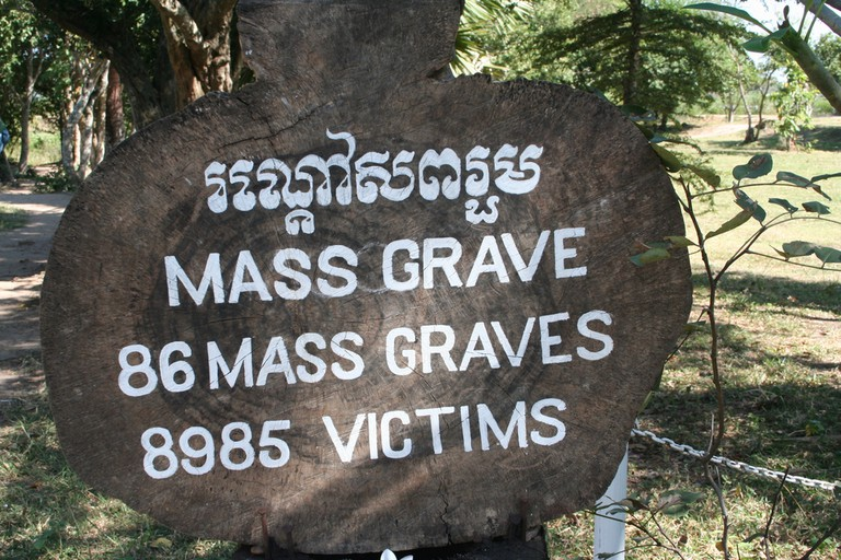 Mass grave sign at the Killing Fields in Cambodia, where more than 8,900 victims were murdered and buried