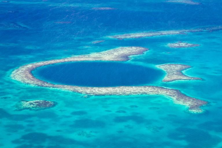 https://www.shutterstock.com/image-photo/aerial-view-great-blue-hole-coast-168178145?src=SMmE_NHJQoPQF-Sdzr8XSA-1-1