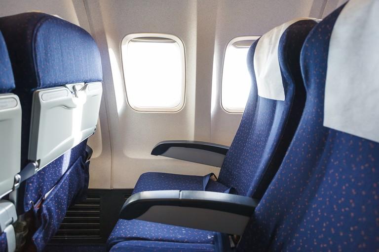 https://www.shutterstock.com/image-photo/blue-seats-economy-class-passenger-section-253922227?src=5TbQsRv88MQouKnrG_J0FQ-1-20