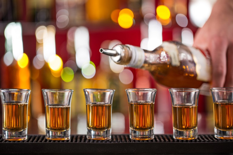 Shots of whisky on a bar | © Lukas Gojda/Shutterstock