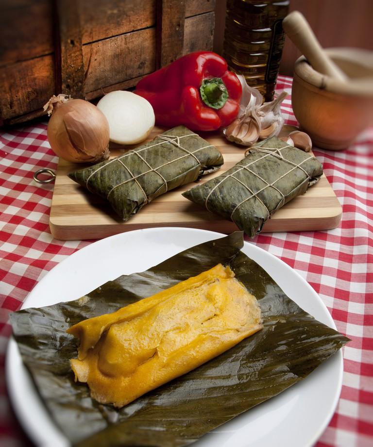 Fresh tamal wrapped in banana leaves | © Carlos Rondon/Shutterstock