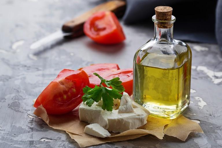 Classic Greek Appetizer, Olive Oil, Feta, and Tomatoes | © Yulia Furman/Shutterstock
