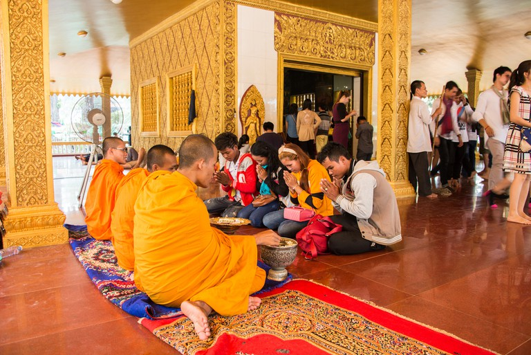 Monks give blessings in a pagoda