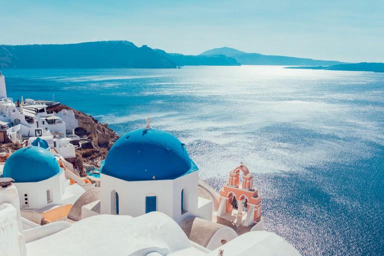 Peering over the cliffs of Santorini   © Anastasios71/Shutterstock