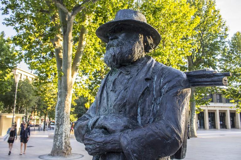 Start the Cézanne trail at his statue at La Rotonde
