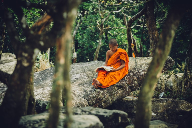 A monk near a temple in Bokor National Park