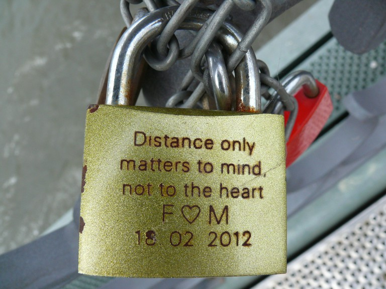 Love locks are often engraved or decorated with stickers and ribbons