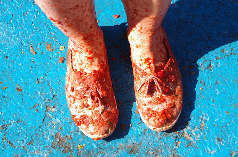Feet covered with tomato slices, La Tomatina, Spain