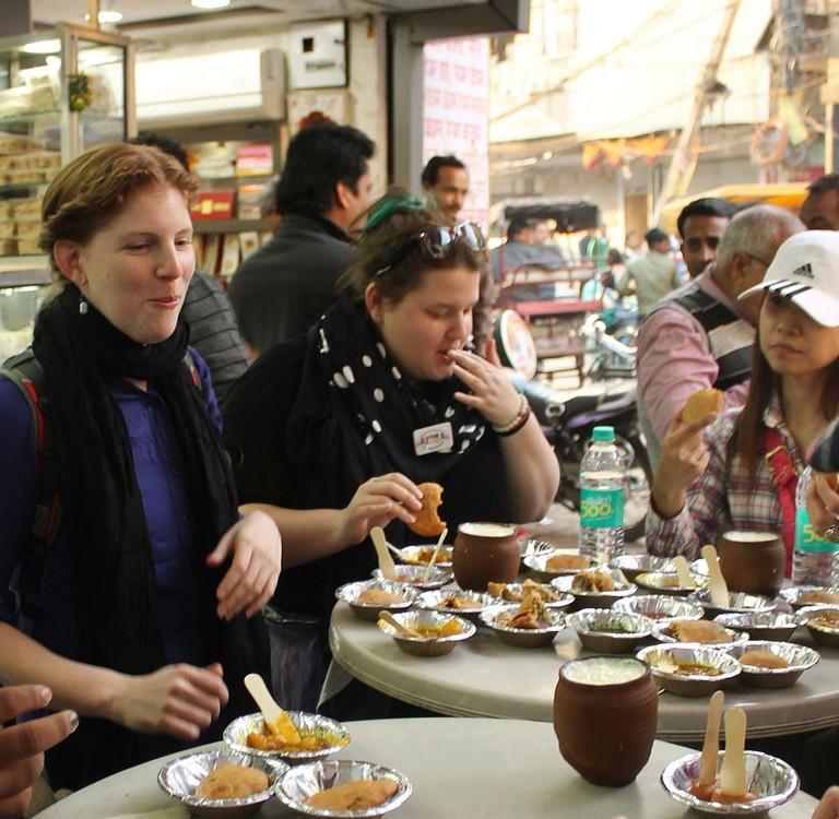 People enjoying Indian street food