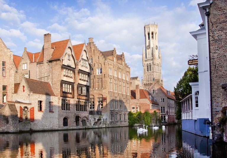 Two couples of swans, making Bruges' Rose Hat Quai even more picturesque | © Jan D'Hondt | courtesy of Visit Bruges