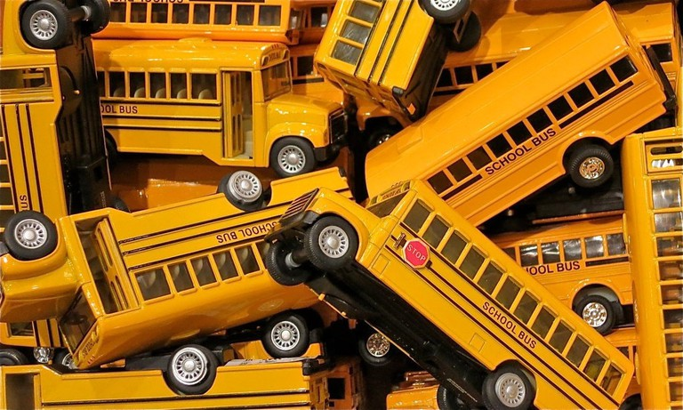 Toy buses, in their ubiquitous golden hue